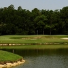A view of the 12th hole surrounded by water at Oaks Golf Club